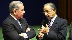 El presidente Danilo Medina y el periodista Huchi Lora.